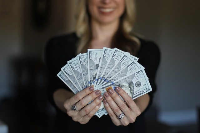 lady holding money on hand