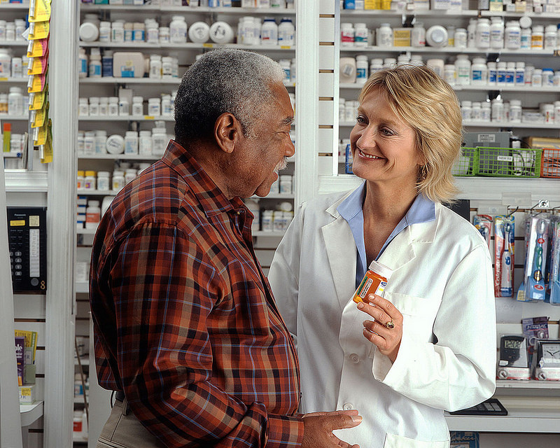 pharmacist giving advice to the patient