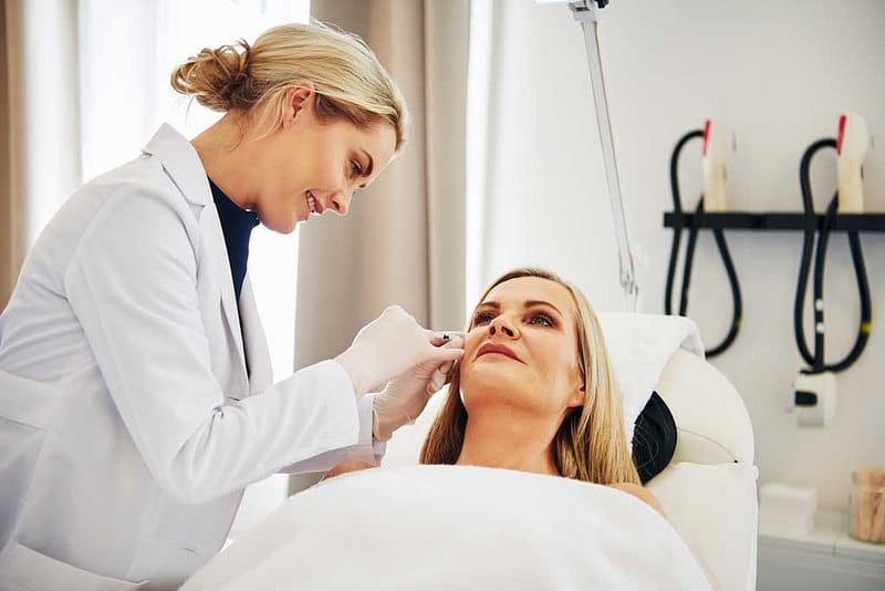 dermatologist checkup the face of the patient