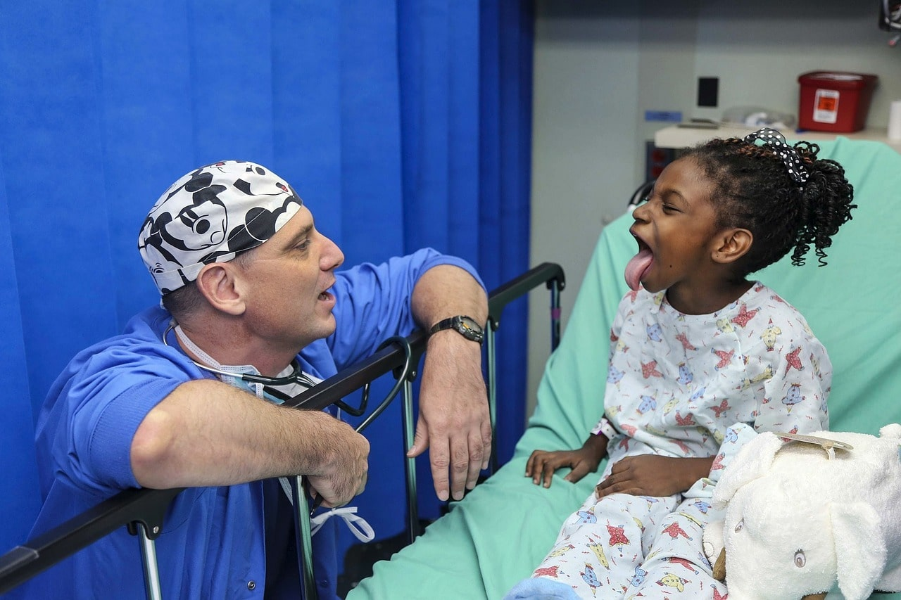 a respiratory therapist and a child in the hospital