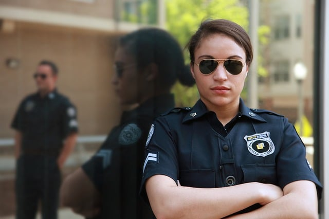 Police woman using shades - police officer salary
