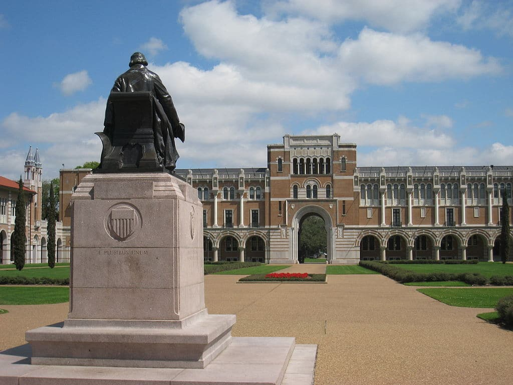 Statue of founder William Marsh Rice and Lovett Hall in its backdrop, both in Rice University, Houston, Texas