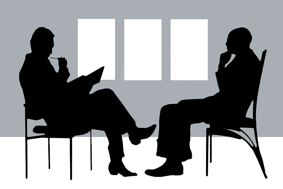 two person sitting facing each other