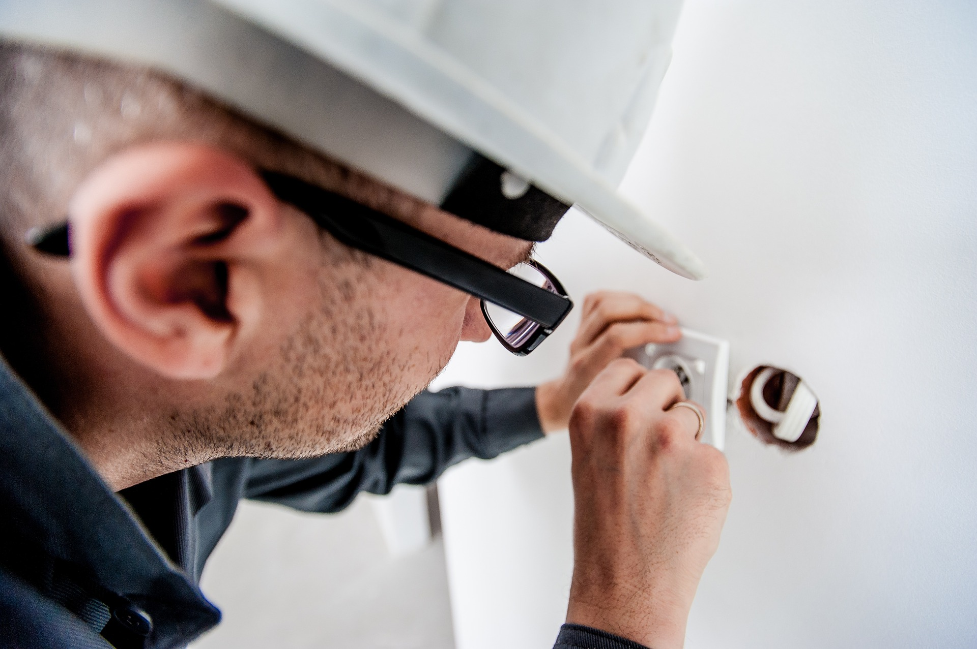 Electrician fixing the electric outlet